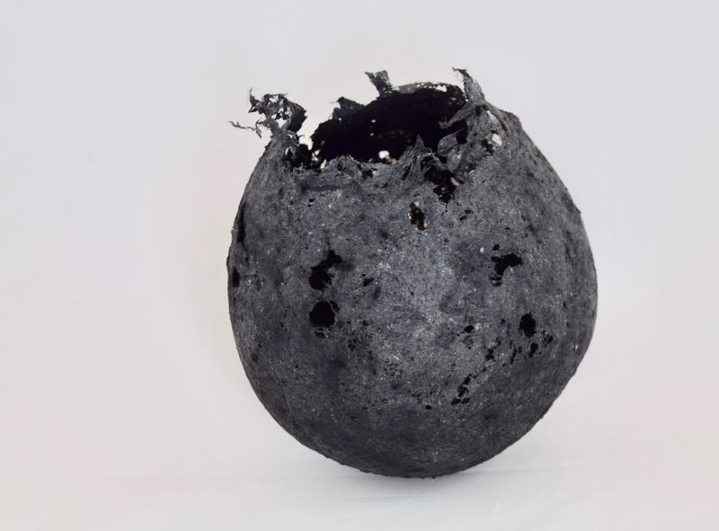 round black soft sphere, made from paper, open at the top