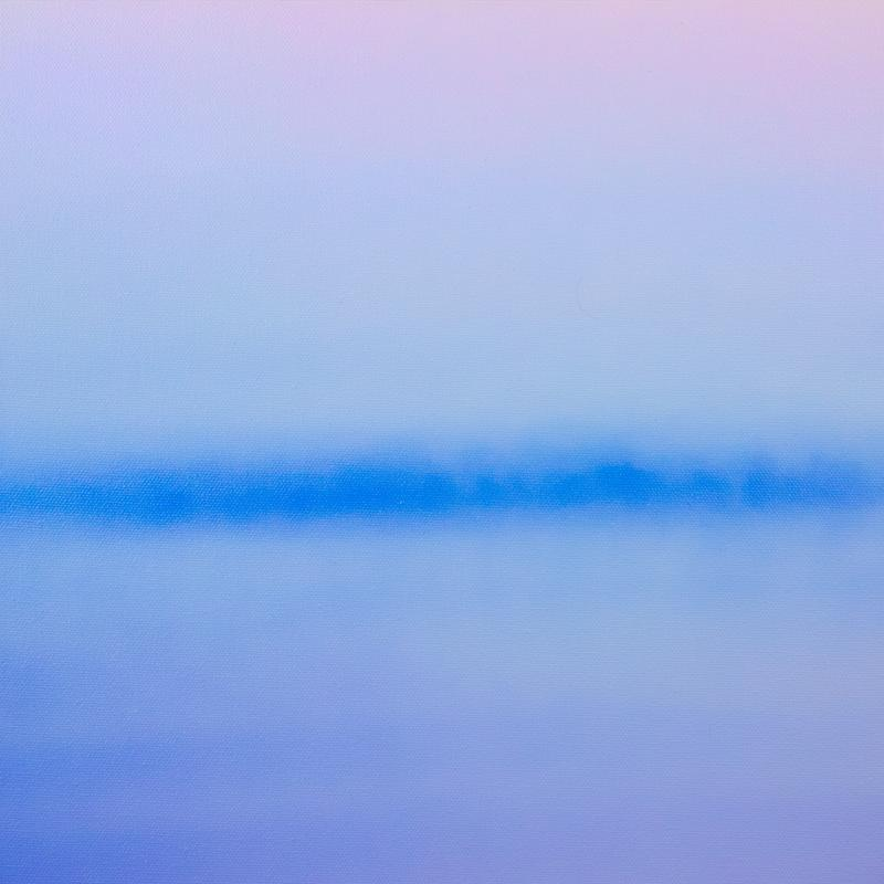An abstract photograph of an evening spent looking towards the distant horizon across a calm lake. The fading  light of the sunset reflects purple and blue hues across the waters surface, split by a blue silhouette of a distant tree line across the middle.