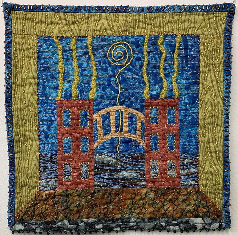 A quilt with beads and embroidery showing two buildings connected by a bridge.  There is a beaded spiral in the sky.