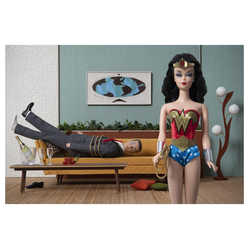 A photograph of Barbie as Wonder Woman utilizing her Lasso of Truth to subdue Ken