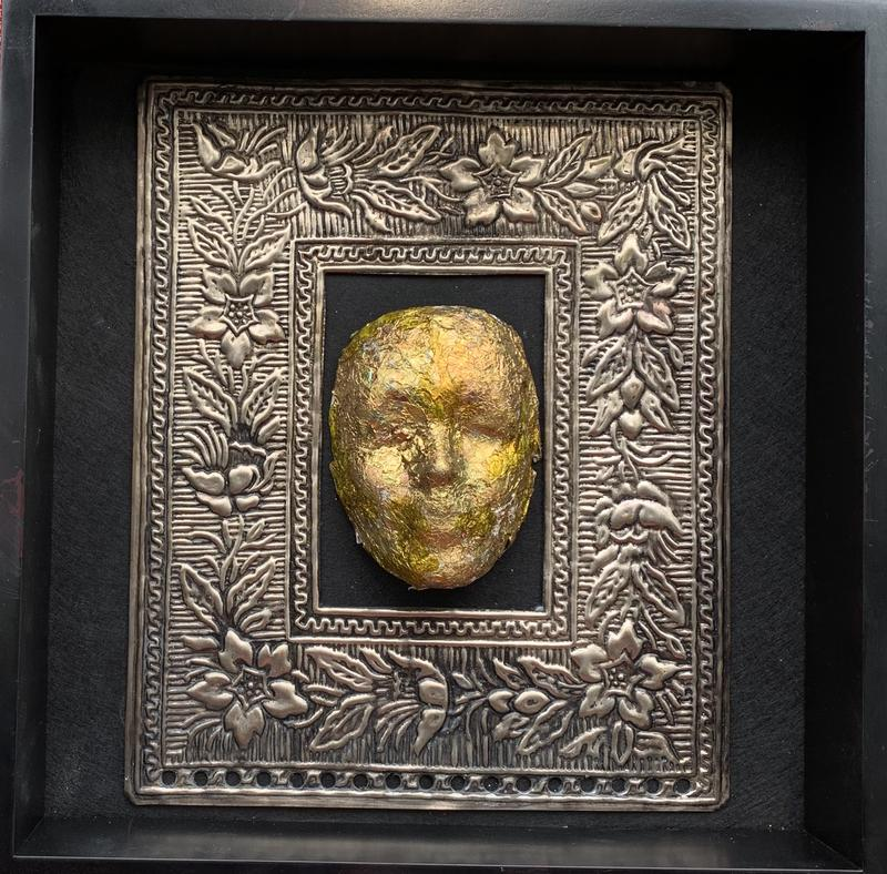 A life mask memoriam, was created to honor those have gone before us, using recycled materials.