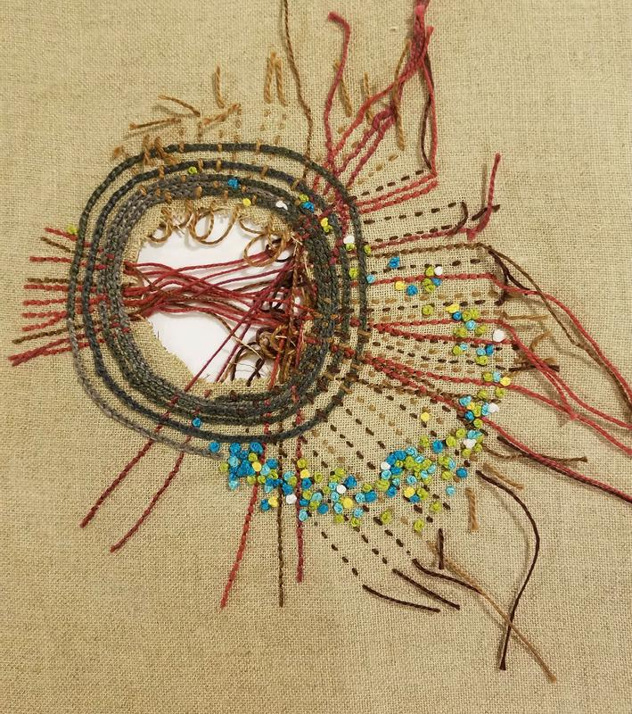 Embroidery on linen using chain, back, running stitches, and french knots. There is a hole torn off to the left side. Stray threads are seen entering and exiting the opening.