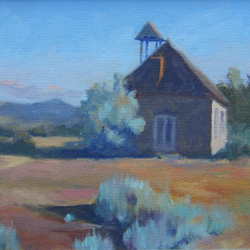 A painting of an historic one room schoolhouse located in northern wyoming with the sun low in the sky.