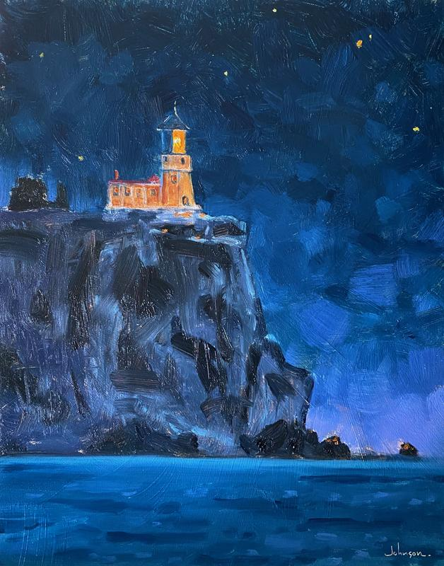 Iconic Split Rock Lighthouse shining forth, with starlight for companionship.