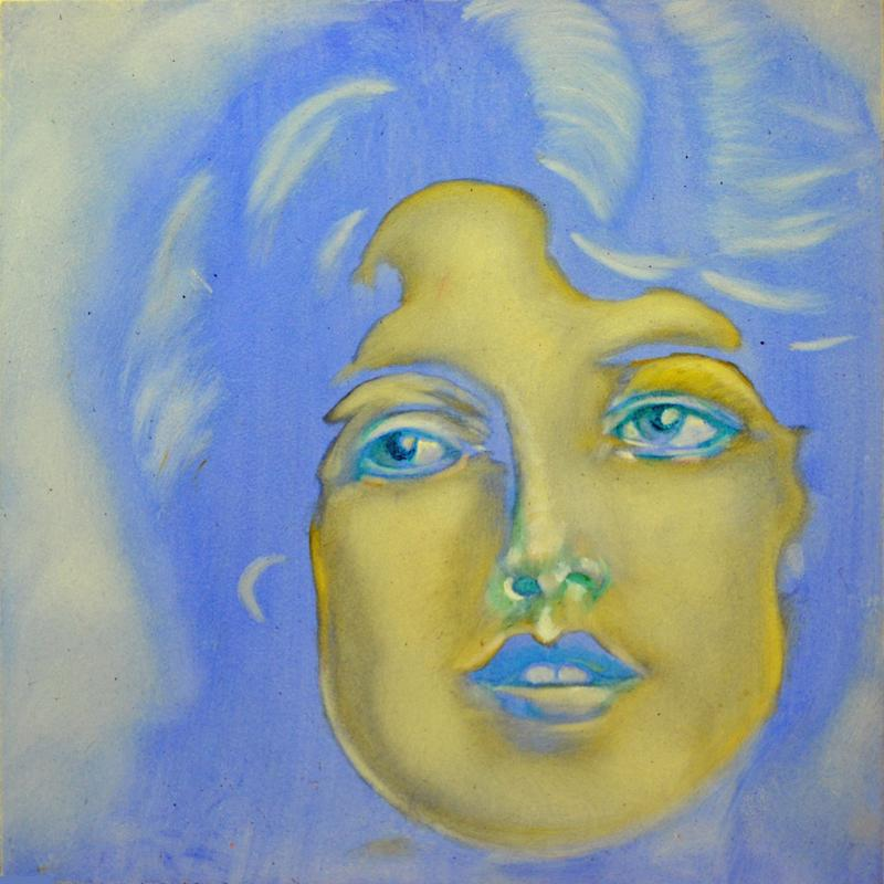 Dreaming the Blue depicts a young woman in various shades of blue. The portrait expresses an ethereal dream like quality.