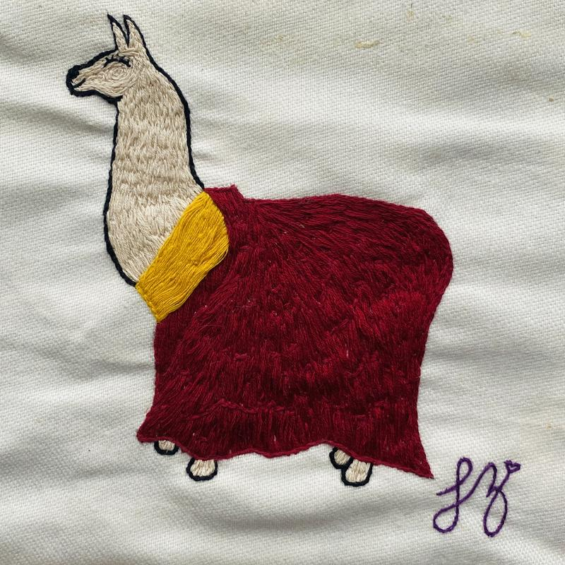 A reverent llama dressed in the traditional dress of his Holiness the Dalai Lama.