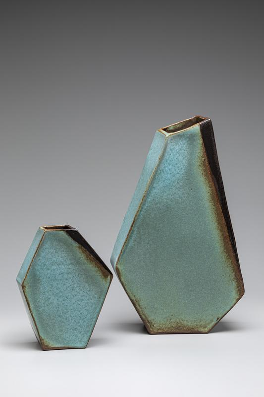 A pair of Ikebana vases, designed to appear off-centered but balanced