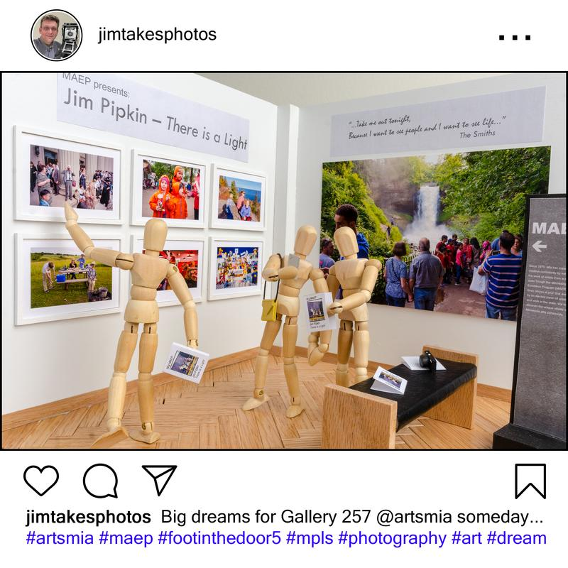 Image is a social media post about a 1/12th scale diorama of Minnesota Artists Exhibition Program gallery at the Minneapolis Institute of Arts (Mia) showing an exhibit of photographs by Jim Pipkin.  Small wooden artist's manikins are in the scene enjoying the exhibit and taking a selfie.