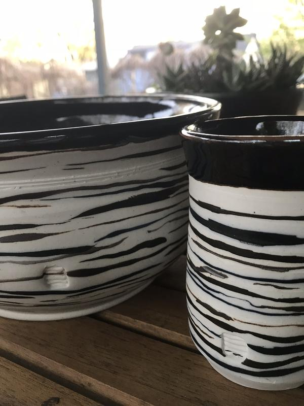 Two porcelain hand thrown bowls dialogue. Hand scribed glazed lines define shape, rhythm and story.