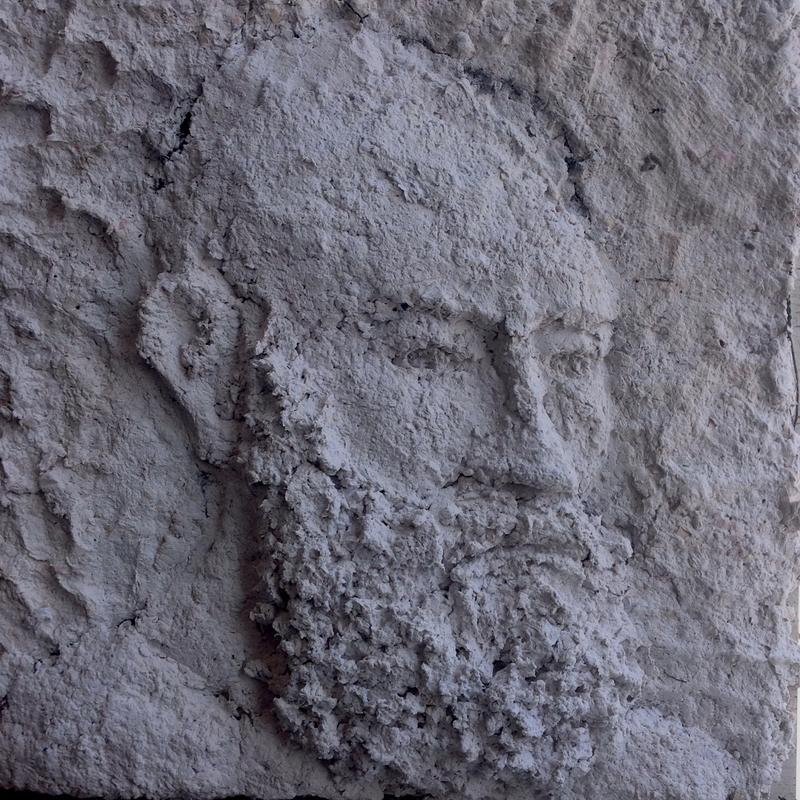 This is my self-portrait (my head and neck are visible). It is made in low relief with the image projecting slightly out towards the picture plane. It is very textural as I built the sculpture using handmade paper pulp from recycled paper. It is all white, with some areas of grey and off white.