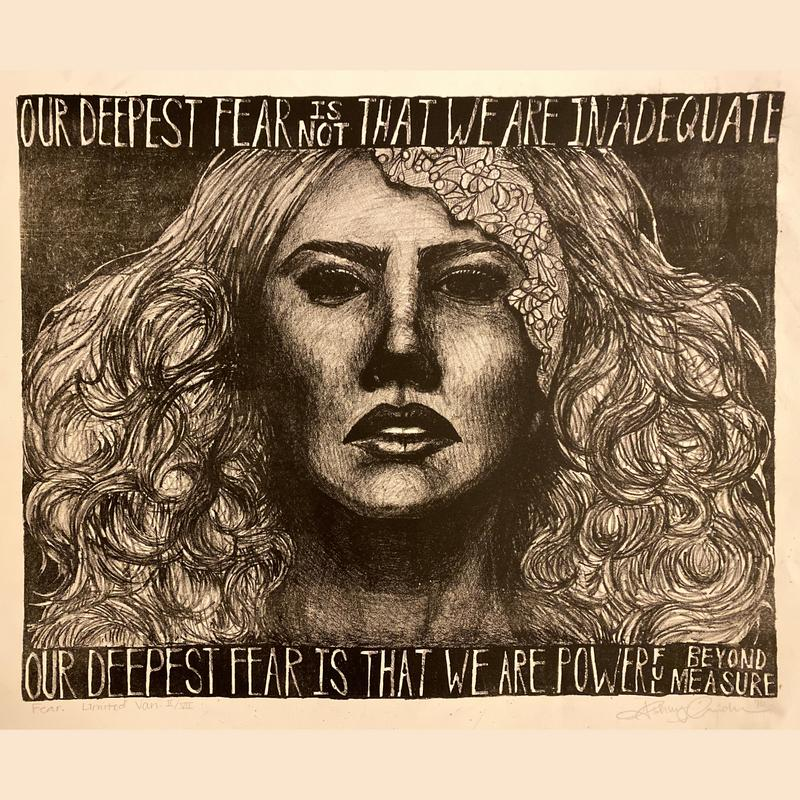 """A lithograph of a modern-day queen drawn in black in white. She is dramatically lit with striking emphasis on her bold facial features and unruly hair. She is framed by the quote """"Our deepest fear is not that we are inadequate. Our deepest fear is that we are powerful beyond measure."""""""