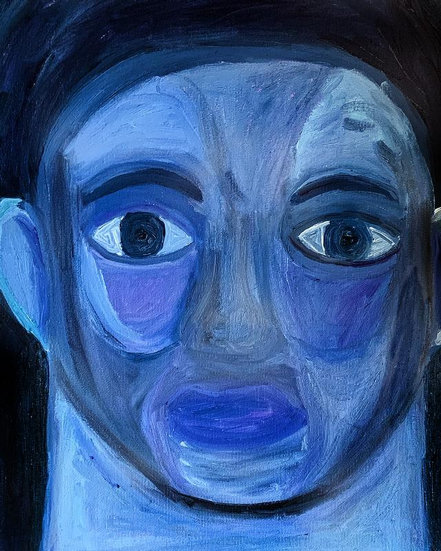 A straight-on blue face portrait of a man who stares at the viewer.