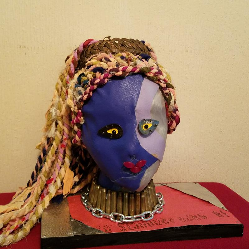 mixed media....otherworldly woman..using authentic finds