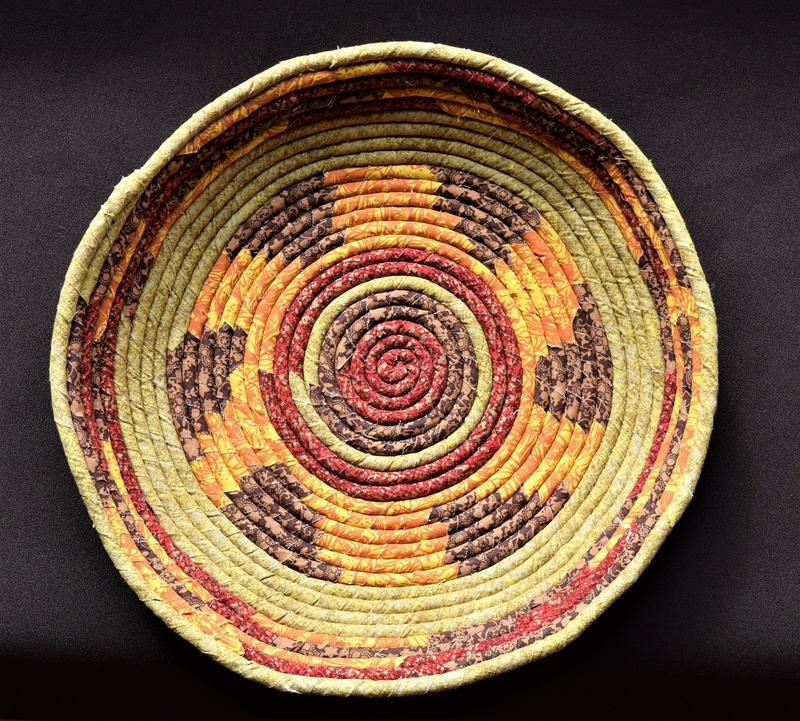 a basket made with warm colors and geometric design