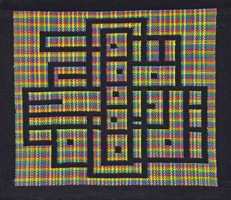 Doubleweave line design with cotton yarn. Lines are in black with a multiple color background.  Dark, but also bright.