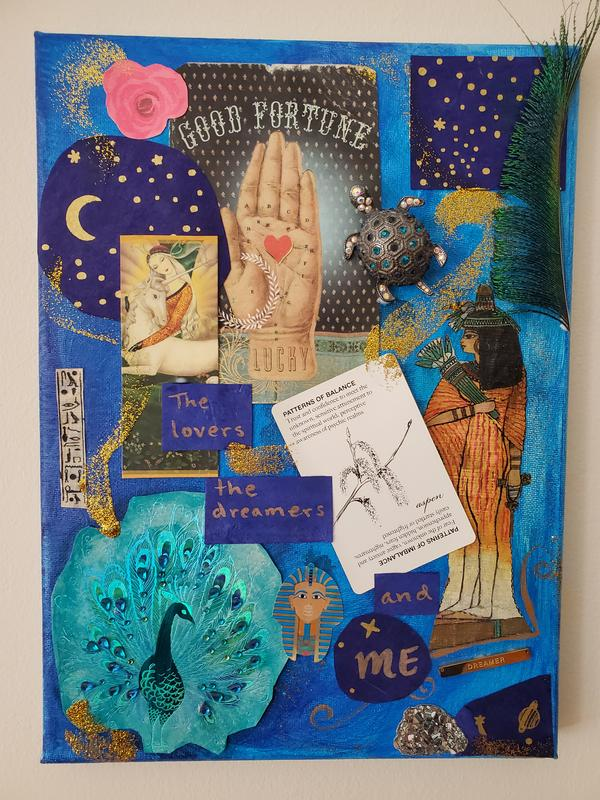 A cerulean blue collage with celestial images, swirling gold glitter, cut-outs of Egyptian papyrus art, and a peacock feather.