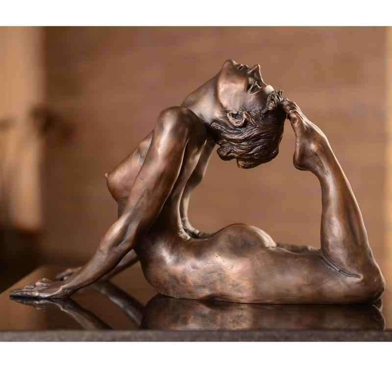 """A bronze sculpture created from a live model who held the pose where her body created the shape of an """"O"""" for three hours.  People typically exclaim """"Oh!"""" when they see the sculpture and understand how it was made."""