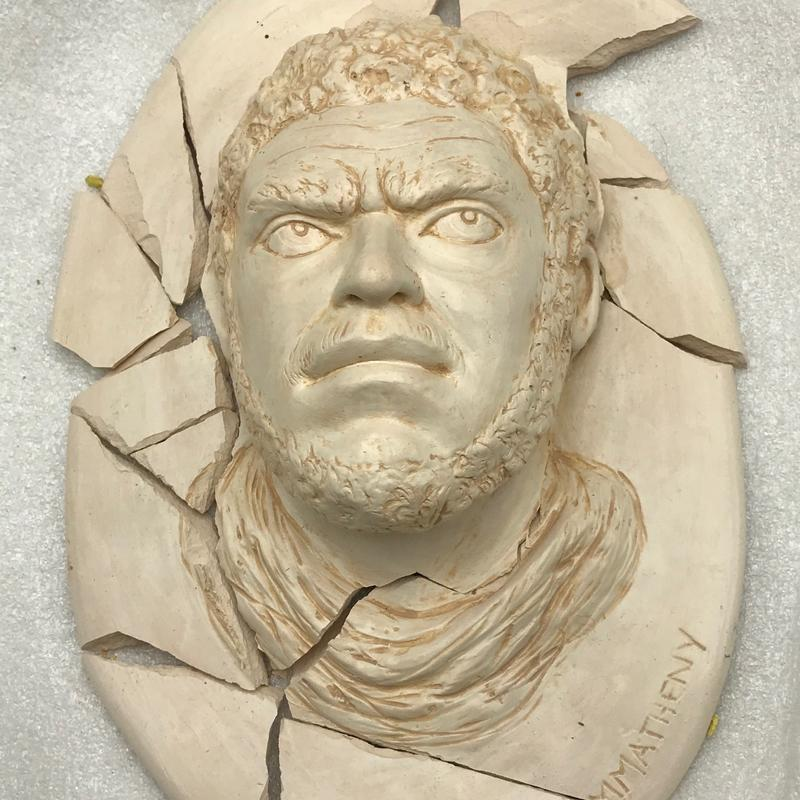 """""""Broken Promise: Black Lives Matter"""". Classical portrait of male head in white porcelain clay. Broken shards portray disappointment at failed efforts to find racial justice."""