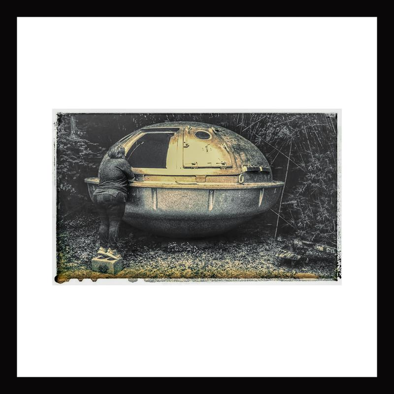 In a secluded grove of trees and shrubbery, a woman, seen from behind, stands on her tiptoes on a cement block to peer into the hatch of a rusty silver metallic object that looks like a flying saucer.  The image is a discolored black and white, possibly an old Polaroid.
