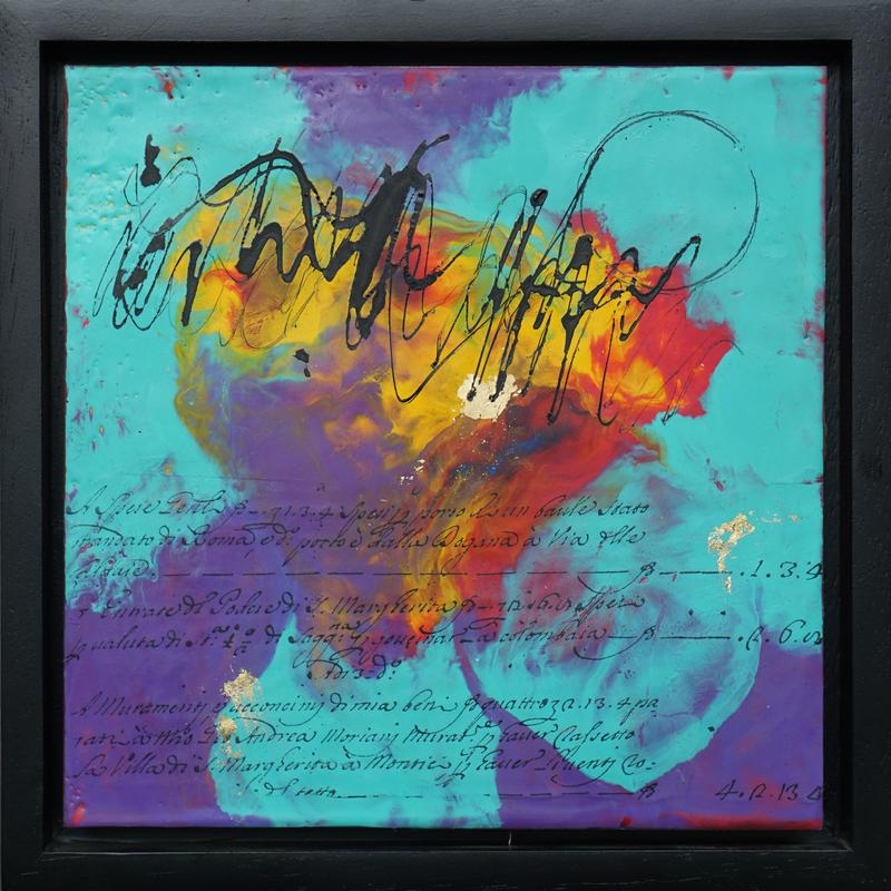 The piece is in a black frame and is square. The background is a swirling psychedelic mix of teal, purple, yellow and red encaustic wax. The wax is mostly smooth but in some places there are areas of texture. In the top half there is a large scribble of black india ink that moves across the piece horizontally. On the right side of the scribble is a large open circle of india ink. On the bottom half there are ink transfers across the entire piece of vintage word plate in another language. Three dollops of gold foil dot the piece in a wide triangle.