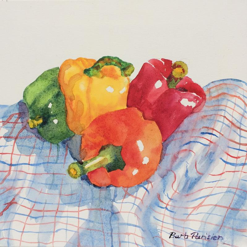 A colorful array of sweet peppers - red, yellow, orange, and green on a plaid tea towel.