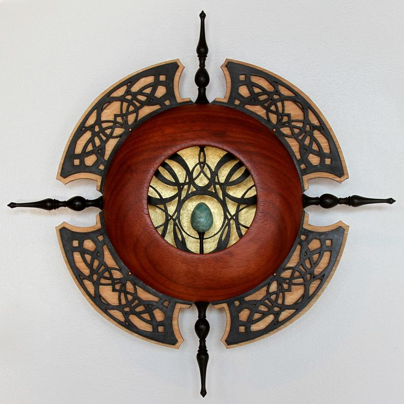 A Padauk and Ebony wood turned sculpture with gold gilding in the form of a Portal with Art Nouveau design influences