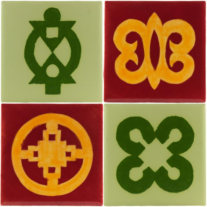 Four hand-glazed tiles in greens, oranges and reds, with contrasting matte and gloss glazes, using Adinkra symbols which mean (clockwise from top left) cooperation, timelessness, faithfulness and cleverness.