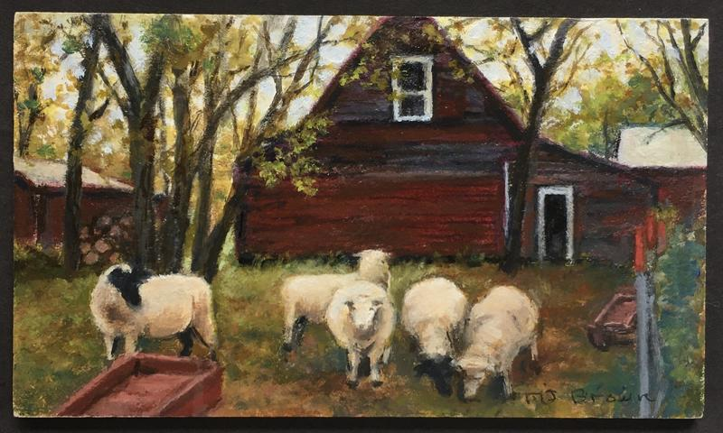 A country side scene of sheep in front of a farm house in rural Minnesota.