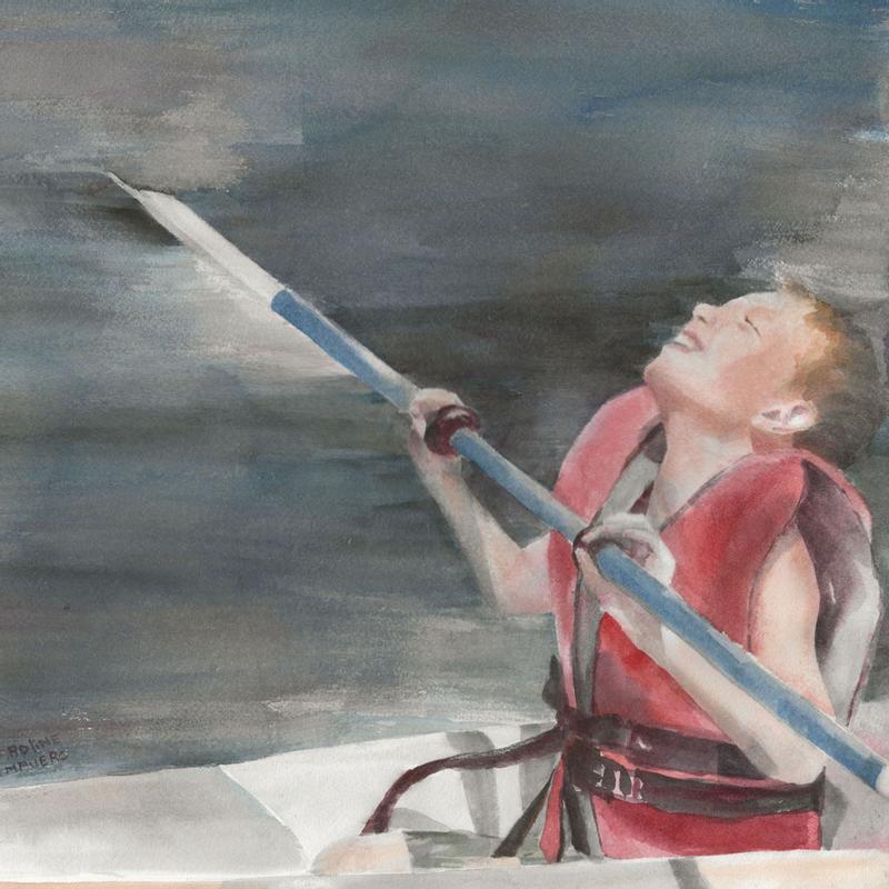 My nephew kayaking on the lake on a beautiful day.