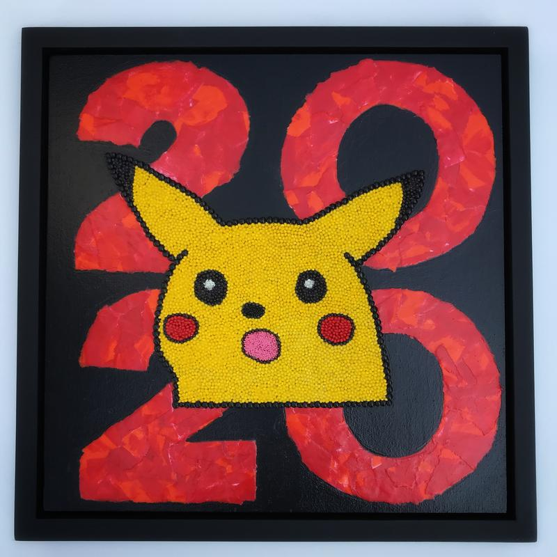 Pikachu with his mouth open in surprise made of natural and hand-painted seeds glued on top of the year 2020 made from red and orange hand-painted and torn paper collage.