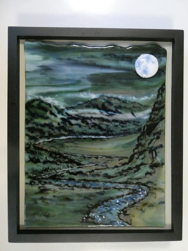 An imagined mountain valley at night with a winding river lit by the glowing full moon above, wisps of clouds among the distant peaks, framed by a steep cliff nearby.