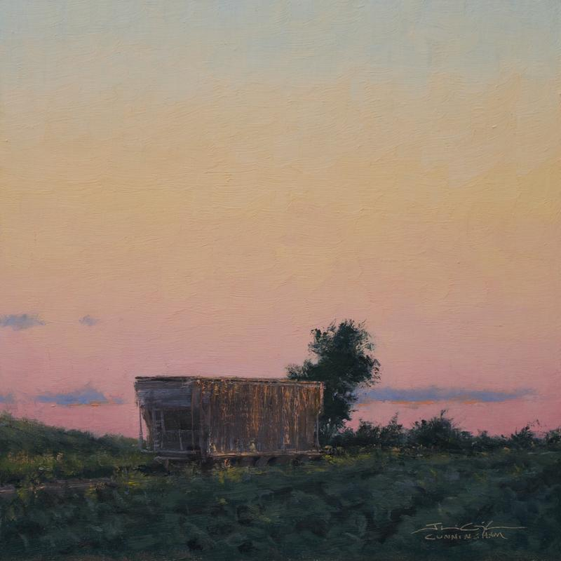 This an oil painting, depicting a rural Minnesota landscape. The upper three-quarters of the painting showcase deepen colors of the sunset before they've given way to the scattered ambiance of the twilight. A lone railroad Hopper car sits next to some scrubby volunteer shrubbery between soybean fields. Its metal body reflecting a bit of the pink and orangy tones of the sunset while the backside of the rail car reflects the cooler notes of the sky behind us.