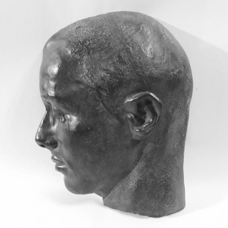 A portrait of a past lover once malleable as clay; cast in cold bronze--hard as memory.