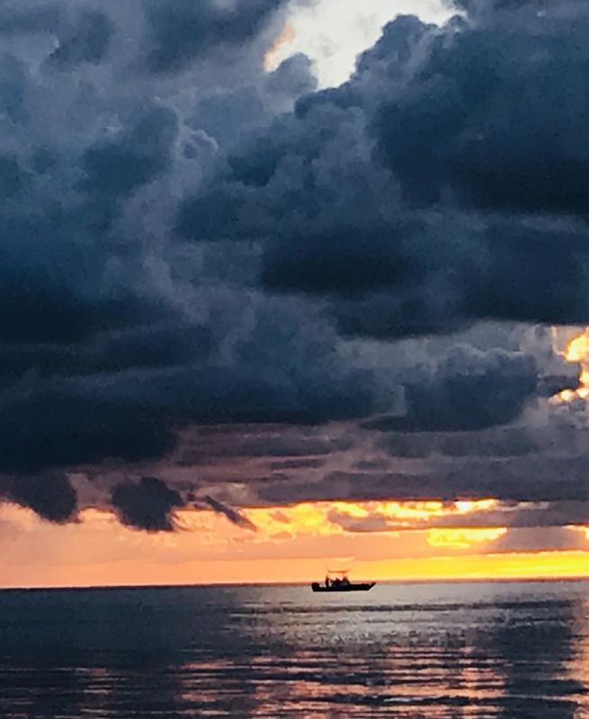 Nature's sky artistry has been influenced by over 20 tropical storms this year. On the Forgotten Coast, FL, a lone fishing boat traverses the Gulf of Mexico, under a stormy, pre-dawn cloudrise.