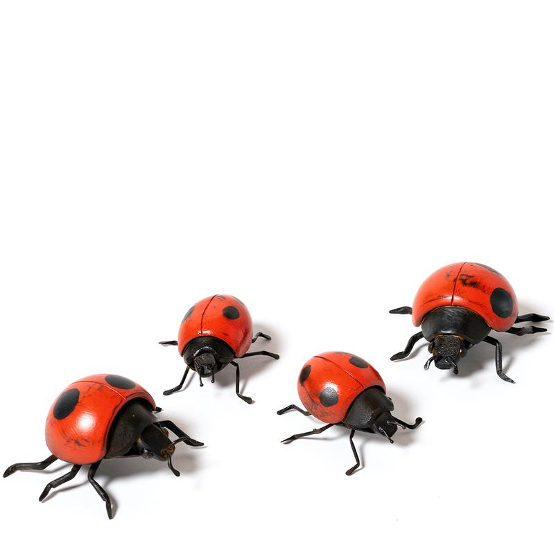 Four forged and fabricated small red and black lady bug sculptures made of steel