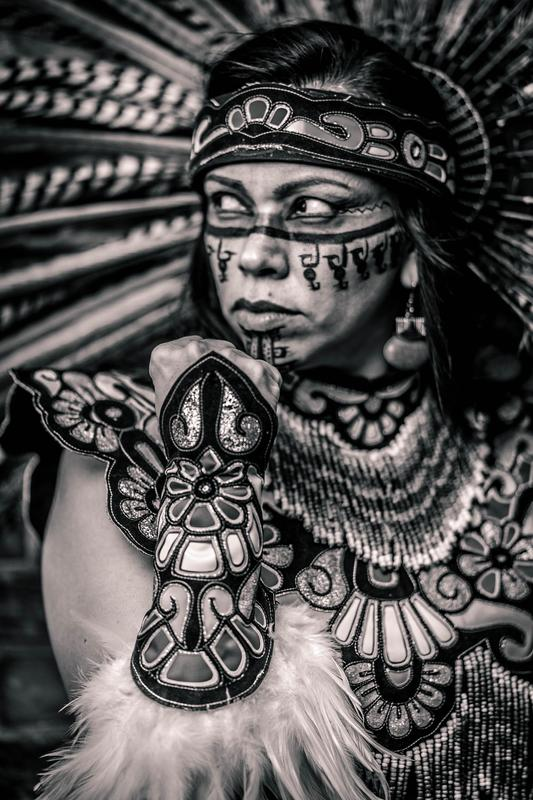 Photo of La Mexica, Mexican Indigenous Woman wearing Danza Atuendo with tribal paint adorned on her face standing Strong, Fierce, Resilient, Fearless because she is Brown and Proud. Visual Artist/Model: Maricella Herrera  Photographer: Pallavi Sharma