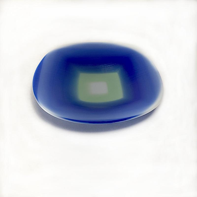 A shallow glass abstract art bowl was made from square layers of white, sea green and cobalt blue glass fused together with heat and pressure. It represents an ocean view on a beautiful breezy day.