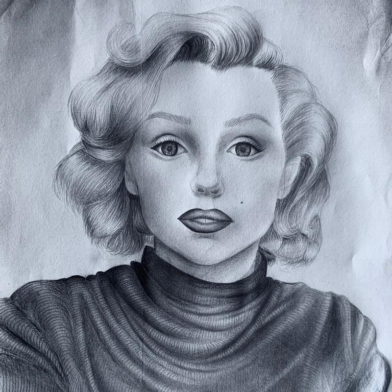 A pencil-drawn portrait of Marilyn Monroe based on a photograph from the 1950's.