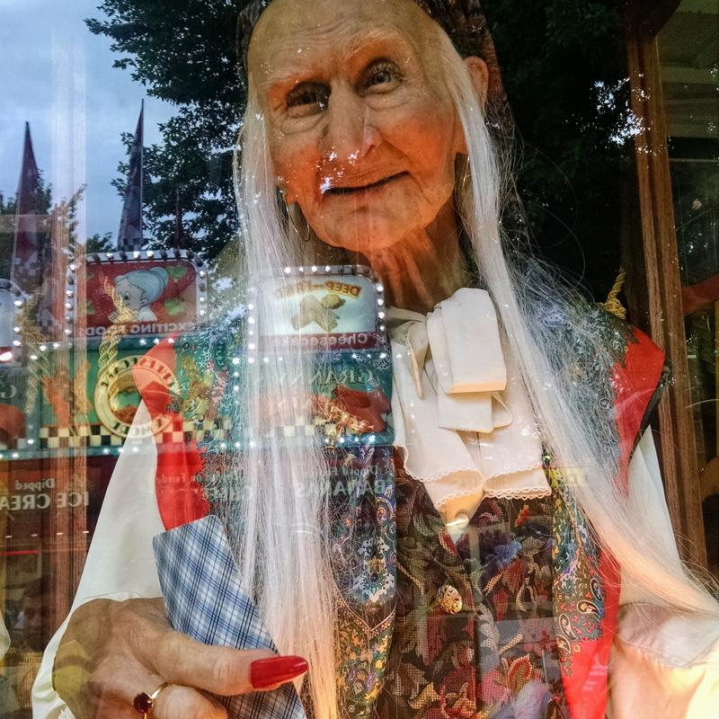 A photograph of a fortune teller inviting you to learn your future, from an automated fortune teller machine at the Minnesota State Fair.