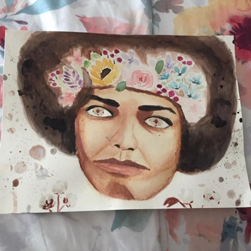 A portrait of Angela Davis, depicting flowers on and around her.
